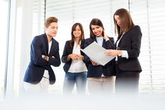 Group of happy young business people in a meeting at office Stock Image