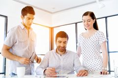 Group of happy young business people in a meeting Stock Photo