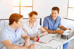 Group of happy young business people in a meeting. At office Royalty Free Stock Images