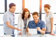 Group of happy young business people in a meeting Royalty Free Stock Images