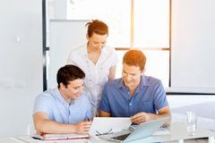 Group of happy young business people in a meeting. At office Stock Image