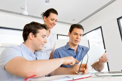 Group of happy young business people in a meeting. At office Royalty Free Stock Image