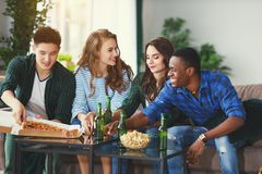 Group of happy friends with beer and pizza at home stock photos