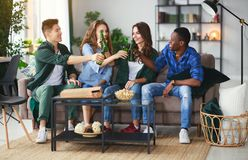 Group of happy friends with beer and pizza at home stock image