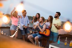 Group of happy friends having party on rooftop Royalty Free Stock Photos