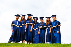Group of happy young graduates Stock Photography