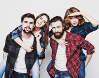 Group of happy young men and women Royalty Free Stock Image
