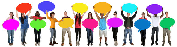 Group of happy young multi ethnic people holding speech bubbles Royalty Free Stock Photos