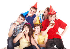 Group of happy young people with cake. Stock Images
