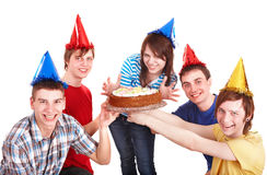 Group of happy young people with cake. Stock Photos