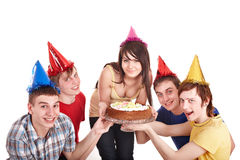 Group of happy young people with cake. Royalty Free Stock Image