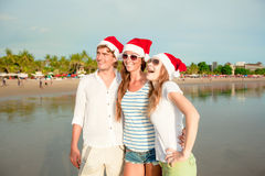 Group of happy young people in christmass hats on Royalty Free Stock Photo