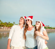 Group of happy young people in christmass hats on Stock Photo