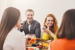 Group of happy young people at dinner table, friends party Stock Image