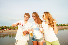 Group of happy young people drinking beer on the Royalty Free Stock Image