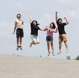 Group of happy young people enjoy with jumping stock photos