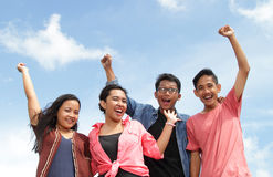 Group of happy young people with hands up royalty free stock photos