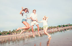 Group of happy young people having great time on Royalty Free Stock Images