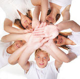 Group of happy young people holding hands Royalty Free Stock Image