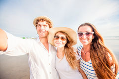 Group of happy young people taking selfie on the Stock Images