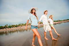 Group of happy young people walking along the Royalty Free Stock Photo