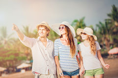 Group of happy young people walking along the Stock Image