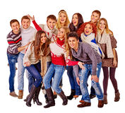 Group of happy young people in warm winter clothes Royalty Free Stock Image