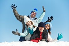 Group of happy young people in winter Stock Images