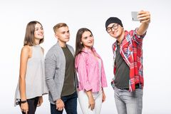 Group of happy young teenager students taking selfie photo isolated on white. Background Royalty Free Stock Photos