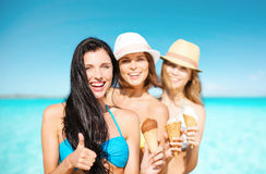 Group of happy young women with ice cream on beach Royalty Free Stock Photography