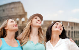 Group of happy young women over coliseum Stock Images