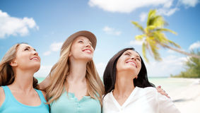 Group of happy young women over summer beach Stock Photos
