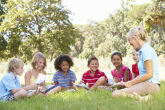 Group Of Having Art Lesson With Instructor In Countryside Royalty Free Stock Image