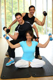 Group having with dumbbells in gym Stock Images