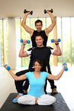 Group having with dumbbells in gym Royalty Free Stock Photo