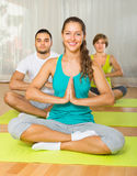 Group having yoga class in sport club Stock Photography
