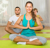 Group having yoga class in sport club Royalty Free Stock Photo