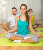 Group having yoga class in sport club Stock Photos