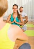 Group having yoga class Stock Photo