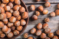 Group of hazelnuts. On wooden rustic background Royalty Free Stock Images
