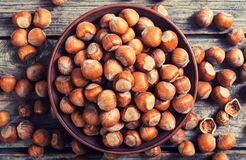 Group of hazelnuts. On wooden rustic background . Healthy food Stock Photo