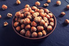 Group of hazelnuts. On stone rustic background Royalty Free Stock Images