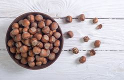 Group of hazelnuts. On wooden rustic background . Healthy food Stock Image