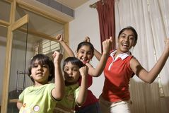 Group of healthy children making expression. Siblings ranging in age from eleven to four are having fun together Stock Photos