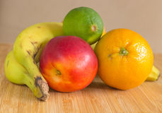 A group of healthy fruits on a bamboo plate. Royalty Free Stock Images