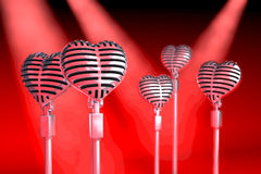 Group of heart shaped classical microphones Royalty Free Stock Photos