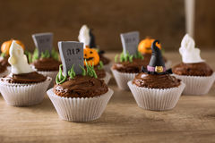 Group of helloween cupcakes on wood table Royalty Free Stock Photography