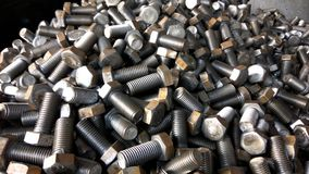 Group of Hex bolts. A close up click of industrial solid alloy lubricated hex bolts factory made royalty free stock images