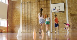 Group of high school kids playing basketball. In the court stock footage