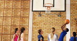 Group of high school kids playing basketball stock video